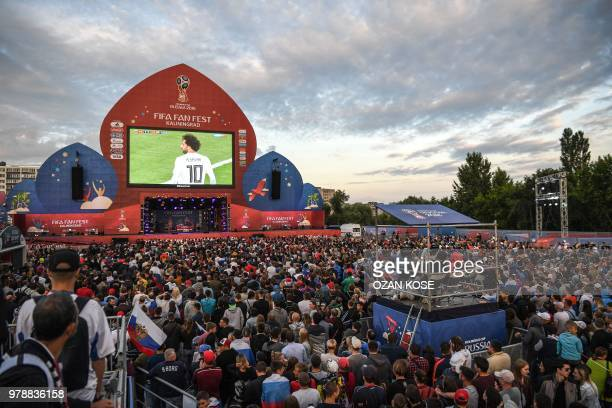 TOPSHOT Russian fans cheer their team during the Russia 2018 World Cup Group A football match between Russia and Egypt at the Fan Zone in Kaliningrad...