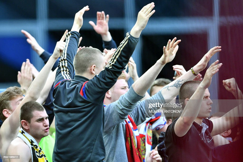 Russian fans gesture and shout slogans during a friendly football match between Russia and Chile at the CSKA Arena in Moscow on June 9, 2017. / AFP PHOTO / Mladen ANTONOV