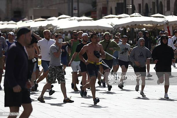Russian fans run at England fans as they clash ahead of the game against Russia later today on June 11 2016 in Marseille France Football fans from...