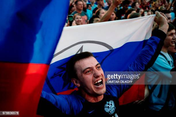 Russian fans watch their team during the Russia 2018 World Cup Group A football match between Russia and Egypt at the Fan Zone in Nizhny Novgorod on...