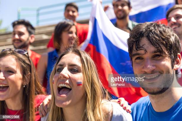 russian fans watching and supporting their team at world competition football league - russian culture stock pictures, royalty-free photos & images