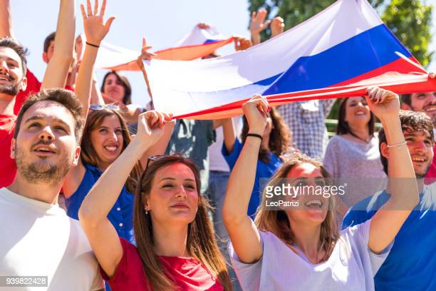 Russian fans watching and supporting their team at world competition football league