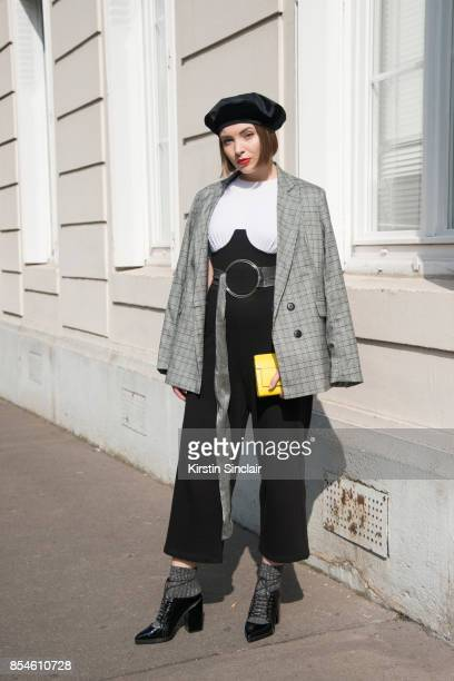 Russian fashion blogger and producer Lisaveta wears a Stradivarius jacket ASOS belt shoes and jumpsuit Furla bag and Zara hat day 1 of Paris Womens...