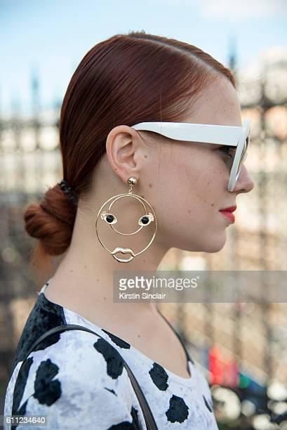 Russian fashion blogger Evgeniya Gvozdeva wears Vintage sunglasses and body suit and Bershka earrings on day 2 of Paris Womens Fashion Week...