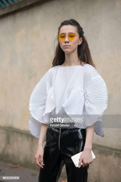 Russian fashion blogger Liza Gysevskaya wears a Vintage top I AM GIA pants and Misha4sure sunglasses day 1 of Paris Womens Fashion Week Spring/Summer...