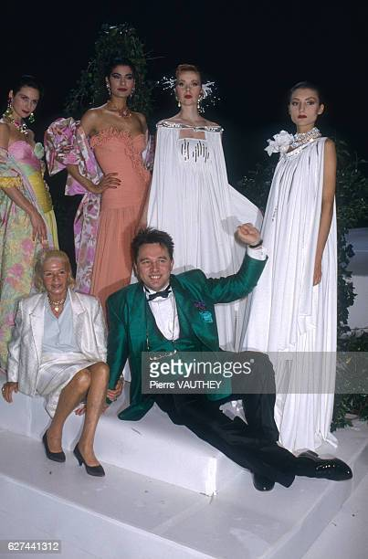 Russian fashion designer Slava Zaitsev with French fashion designer Madame Carven and models wearing his haute couture evening gowns The fashions...