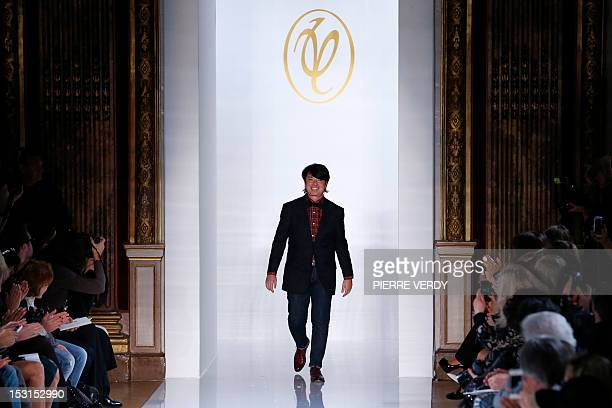 Russian fashion designer Valentin Yudashkin acknowledges the public at the end of his Spring/Summer 2013 ready-to-wear collection show on October 1,...