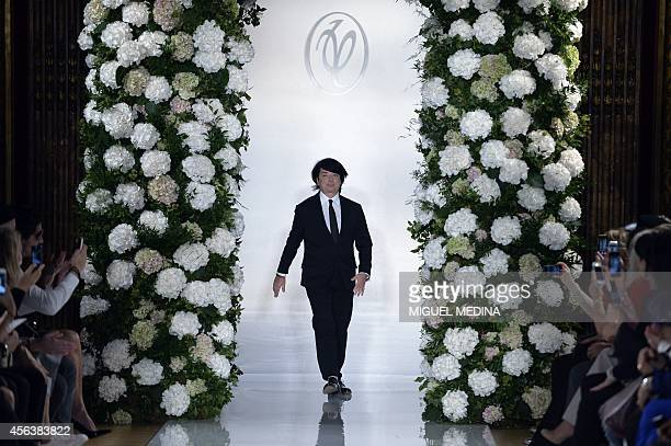 Russian fashion designer Valentin Yudashkin acknowledges the public at the end of his 2015 Spring/Summer ready-to-wear collection fashion show, on...