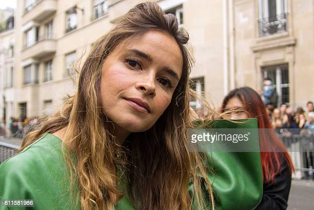 Russian fashion editor and blogger Miroslava Duma arrives for a fashion show during the fashion week in Paris on September 30 2016 / AFP /
