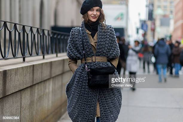 Russian fashion model Irinia Liss wearing a grey scarf a black beret and a brown trench coat seen outside BCBG Max Azria during New York Fashion Week...