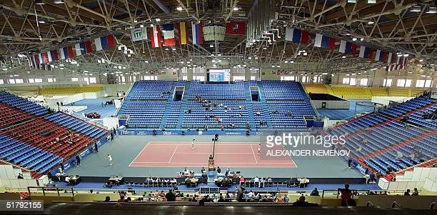 A picture taken from the quite empty stands during game nr 4 of the semifinals of the Fed Cup final four tournament between France's Marion Bartoli...