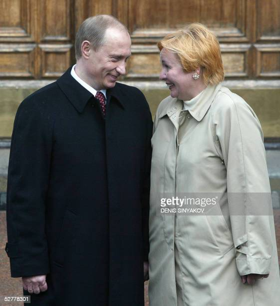 Russian President Vladimir Putin and his wife Ludmila share a laugh prior the military parade 09 May 2005 on the Red Square in Moscow during the...