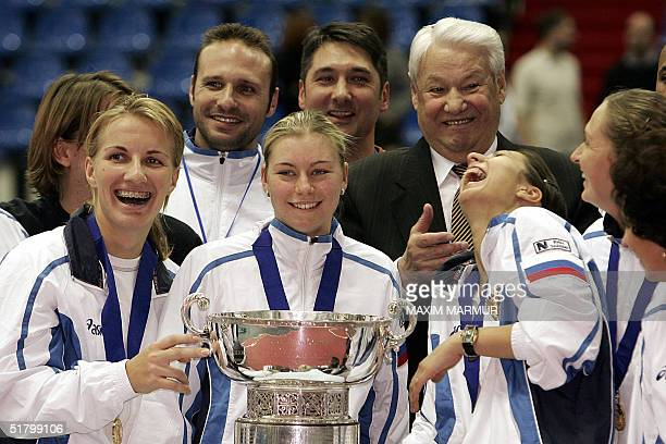 Russian Federation: The Russian Fed Cup team celebrate their victory with former Russian President Boris Yeltsin 28 November 2004 at the newly-built...