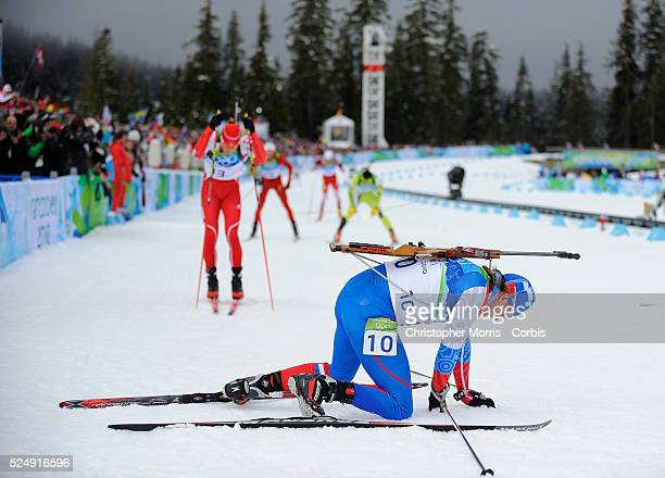 Russian Federation's Ivan Tcherezov collapses in exhaustion after the men's biathlon 125 km pursuit at Whistler Olympic Park on day 5 of the...