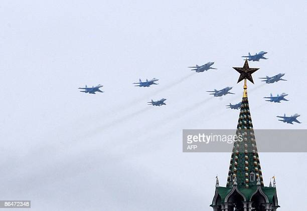 Russian fighter jets fly over St Basil's Cathedral on Red Square in Moscow on May 7 2009 during a dress rehearsal for the May 9 Victory Day parade...