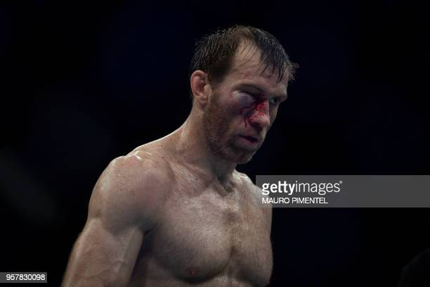 Russian fighter Sultan Aliev walks out of the ring after being defeated by Brazilian fighter Warlley Alves during welterweight bout at the Ultimate...