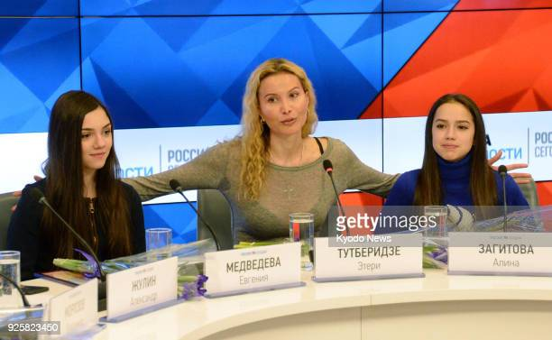 Russian figure skaters Alina Zagitova and Evgenia Medvedeva and their coach Eteri Tutberidze attend a press conference in Moscow on March 1 2018...