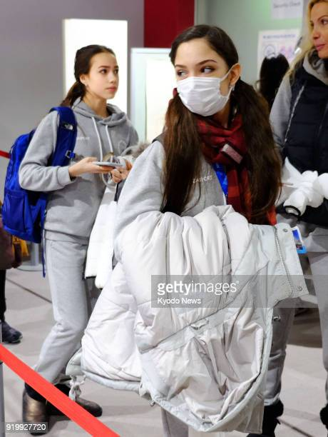 Russian figure skaters Evgenia Medvedeva and Alina Zagitova are pictured at Niigata airport in Japan on Feb 18 ahead of their departure for the...