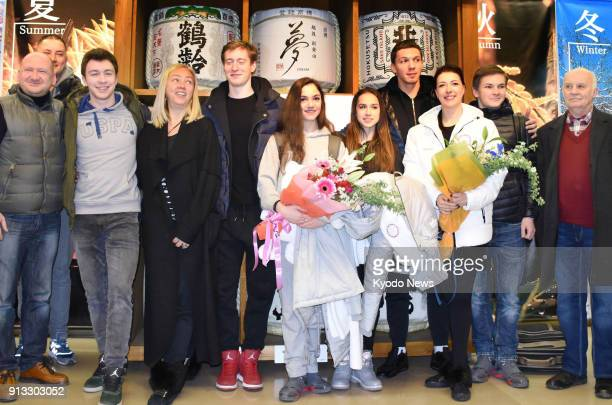 Russian figure skaters Evgenia Medvedeva and Alina Zagitova pose for photos at Japan's Niigata Airport on Jan 28 after arriving for training ahead of...