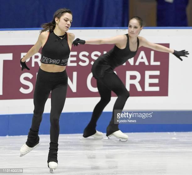 Russian figure skaters Evgenia Medvedeva and Alina Zagitova take part in official training in Saitama near Tokyo on March 18 for the World Figure...