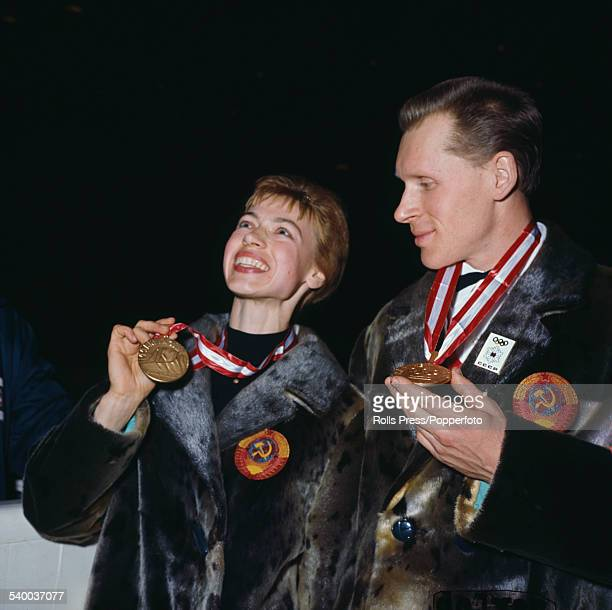 Russian figure skaters Ludmila Belousova and Oleg Protopopov pictured together with their Olympic gold medals for pair skating awarded at the 1964...