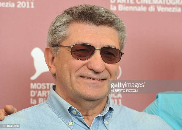 """Russian film director Alexander Sokurov poses during the photocall of """"Faust"""" at the 68th Venice Film Festival on Spetember 8, 2011 at Venice Lido...."""