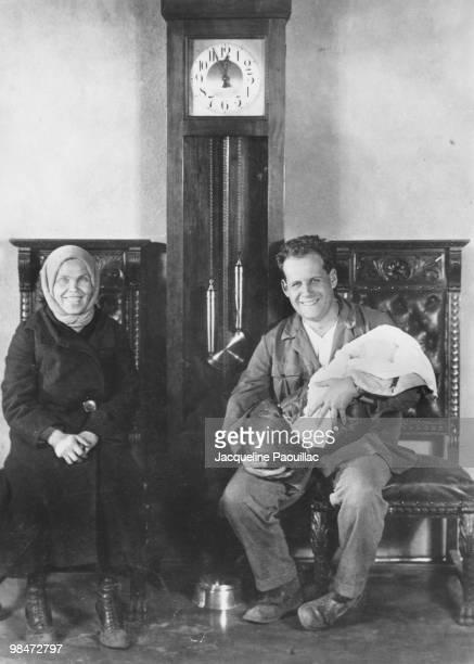 Russian film director Sergei Mikjailovich Eisenstein holding the child of actress Marfa Lapkina 1929 Lapkina starred in Eisenstein's film 'Staroye I...