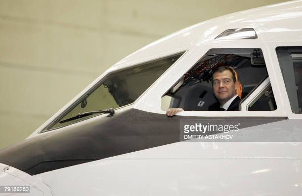 Russian First Deputy Prime Minister and presidential candidate Dmitry Medvedev sits in the cockpit of an Ilyushin-96 airplane during his working...
