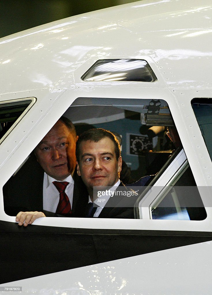 Russian First Deputy Prime Minister Dmitry Medvedev, right, top presidential candidate, looks from the window of Russian Il-96-400T cargo jet produced at the Voronezh aircraft-making plant in Voronezh, some 475 kilometers (300 miles) south of Moscow, Russia, 24 January 2008. As the election drew close, Medvedev has traveled across Russian provinces in trips aimed to secure his overwhelming lead by catering to different groups of voters.