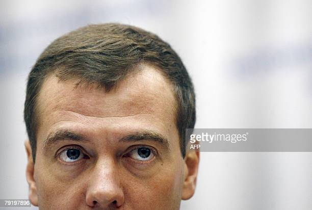 Russian First Deputy Prime Minister Dmitry Medvedev, top presidential candidate, looks on while visiting Voronezh, some 475 kilometers south of...