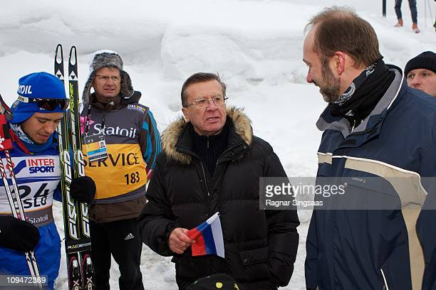 Russian First Deputy Prime Minister Viktor Zubkov talks with Norwegian Minister of Trade and Industry Trond Giske and bronze medalist Ilia Chernousov...