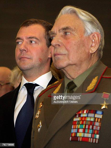 Russian First Vice Premier and presidential candidate Dmitry Medvedev and a veteran of WW II attend a grand meeting in the Oktyabrsky Grand Concert...