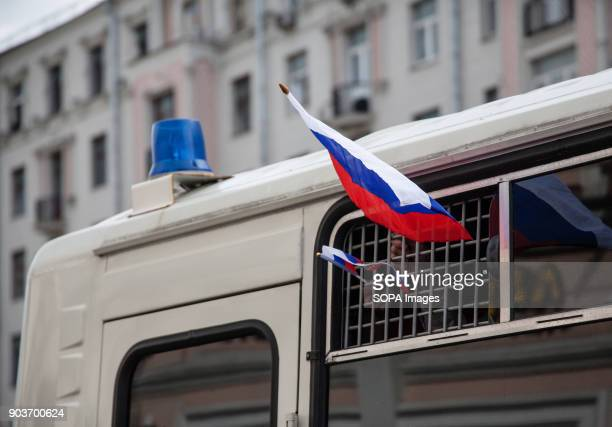 Russian flag being displayed at a police bus Anticorruption protest organised by opposition leader Alexei Navalny at Tverskaya Street