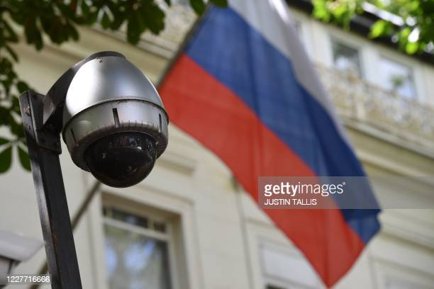 Russian flag flies by surveillance cameras at the entrance to the Russian consulate in London on July 21, 2020. - British lawmakers today slammed the...
