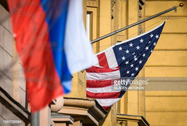 A Russian flag flies next to the US embassy building in Moscow on October 22 2018 US national security advisor John Bolton is in Moscow holding...