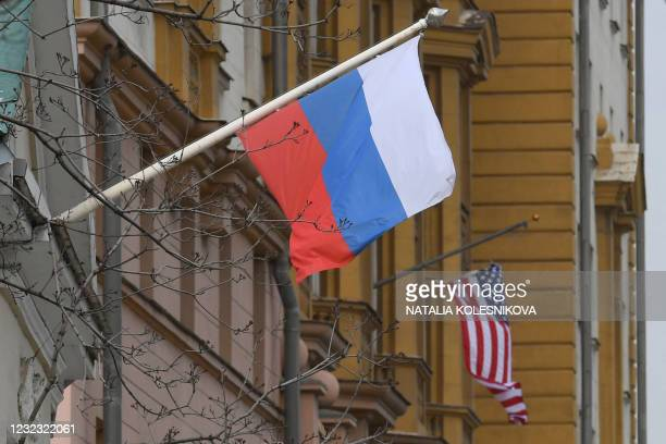 Russian flag flies next to the US embassy building in Moscow on April 15, 2021. - The United States announced economic sanctions against Russia on...