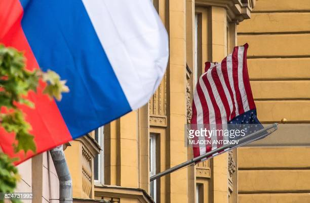 A Russian flag flies next to the US embassy building in Moscow on July 31 2017 President Vladimir Putin on July 30 2017 said the United States would...