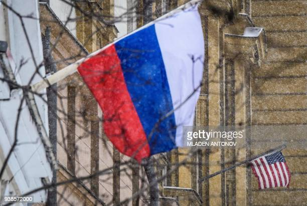 A Russian flag flies next to the US embassy building in Moscow on March 27 2018 The United States and Britain's allies around the world have expelled...