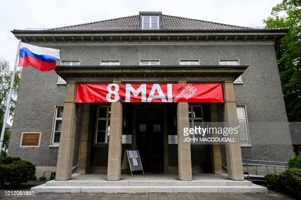 A russian flag flutters next to a banner reading 8th of May in front of the GermanRussian museum in the Berlin district of Karlshorst on May 7 2020...