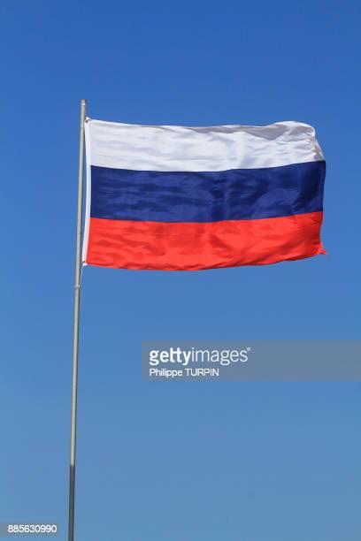 Russian flag in blue sky.