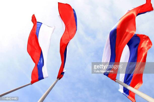 russian flag on a background blue sky - flagpole stock pictures, royalty-free photos & images