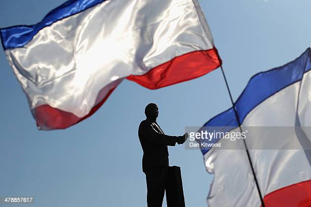 Russian flags wave in front of a monument dedicated to Soviet Union founder Vladimir Lenin during a Pro Russian rally in Lenin Square on March 15,...