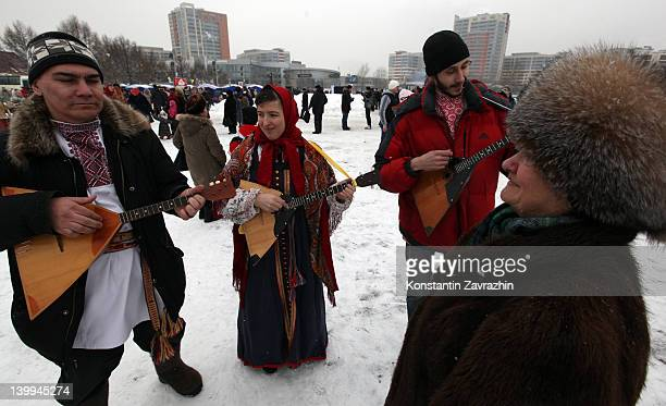 Russian folk singers play balalaikas during Maslenitsa celebrations or Pancake week on February 2012 in Moscow Russia Dating back to pagan time...