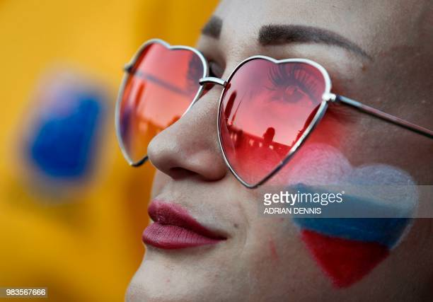 Russian football fan is seen in the FIFA fan zone in Sochi on June 25 watching the Russia 2018 FIFA football World Cup group A match between Uruguay...