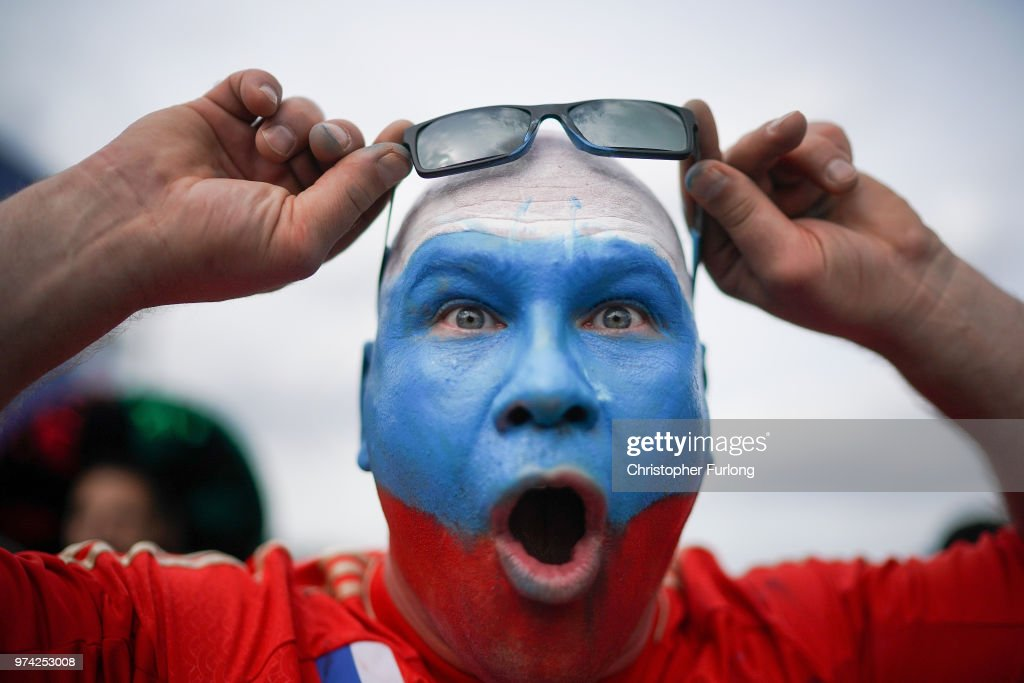 A Russian football fan plays to the camera at the official FIFA Fan Fest at Moscow State University where fans will watch the first World Cup game between Russia and Saudi Arabia on June 14, 2018 in Moscow, Russia. FIFA expects more than three billion viewers of the World Cup competition which begins today.