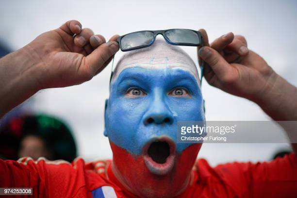 Russian football fan plays to the camera at the official FIFA Fan Fest at Moscow State University where fans will watch the first World Cup game...