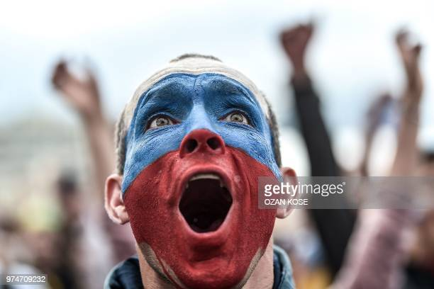 Russian football fan reacts as he watches the Russia 2018 World Cup Group A football match between Russia and Saudi Arabia at the Fan zone in...