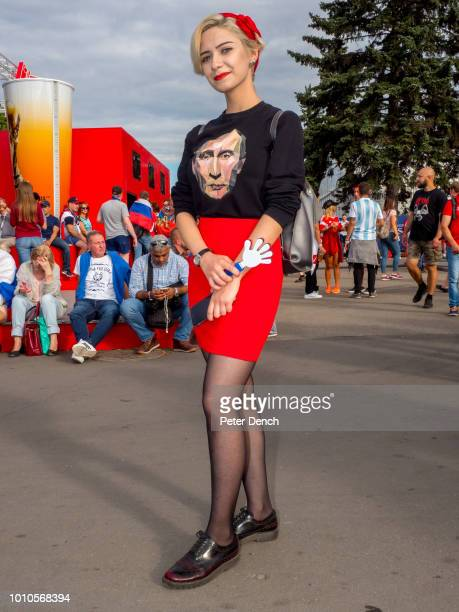 Russian football fan with a TShirt featuring Vladimir Putin the former intelligence officer serving as President of Russia since 2012 previously...
