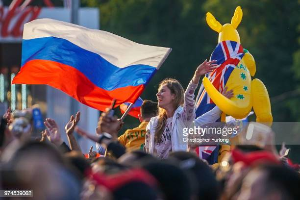 Russian football fans at the FIFA Fan Fest celebrate their team's win against Saudi Arabia at Moscow State University on June 14 2018 in Moscow...