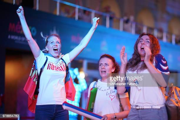 Russian football fans celebrate their national team's 31 win over Egypt as they watch a giant television near Red Square on June 19 2018 in Moscow...